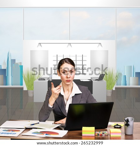 Attractive young woman working at the desk with sticky notes and laptop - stock photo