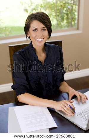 Attractive young woman working on her laptop