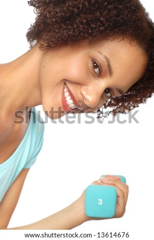 Attractive young woman working out with small weights - stock photo