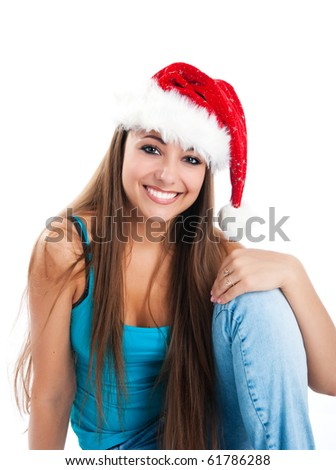 attractive young women in santa claus hat - stock photo
