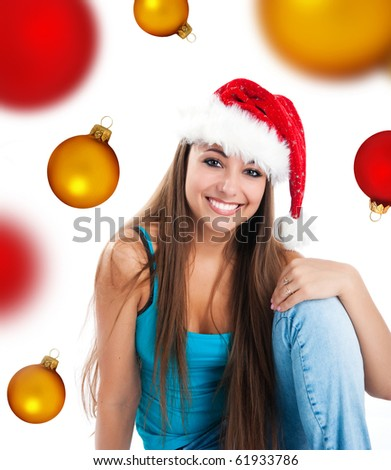 attractive young women in santa claus hat on a spheres background - stock photo