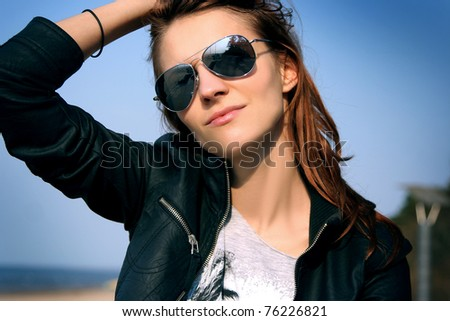 attractive ypung woman relaxing outdoors - stock photo