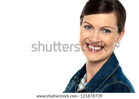 Attractively charming woman with a bright smile. Copy space area towards left. - stock photo