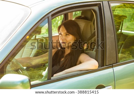 Attrative young woman driving car. Summer vacation trip travel.