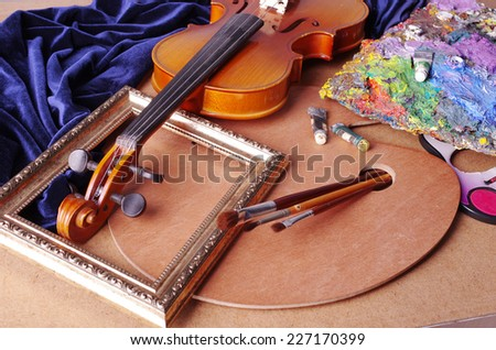Attributes of arts. Violin, frame, palette, brushes, paints and drapery.