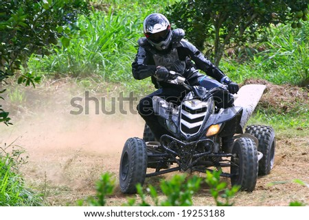 atv racing on dirt track - stock photo