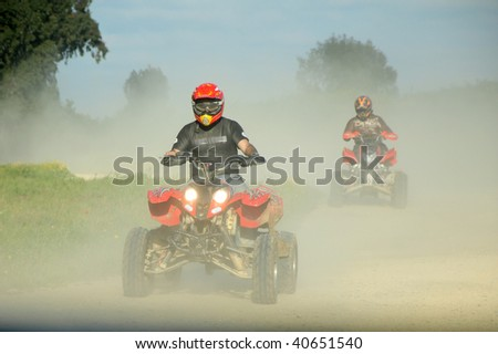 ATV racing outdoors. 2 drives on ATV - stock photo