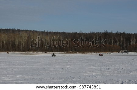 ATVs on the river in winter.
