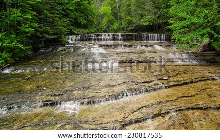Au Train Falls. Located in Michigan's Upper Peninsula is beautiful Au Train Falls. One of many waterfalls in Alger County.  - stock photo