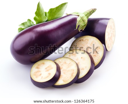 aubergine with leaves isolated on white - stock photo