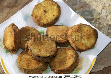 aubergines in a carriage or eggplants in carrozza fried eggplantase with filling of mozzarella - stock photo