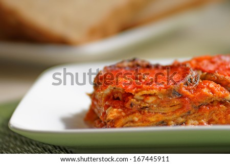 Aubergines parmigiana, typical italian vegan dish. - stock photo