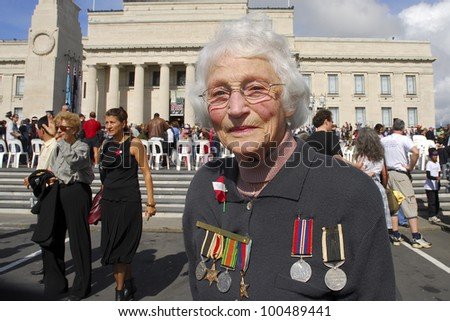 AUCKLAND - APRIL 25: An unidentified woman proudly displays her war medals following the annual ANZAC Day remembrance service, on April 25, 2007 in Auckland, New Zealand. - stock photo