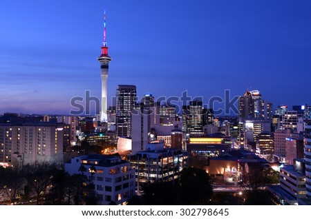 AUCKLAND - AUG 03 2015:Panoramic view of Auckland Sky tower skyline in colors at dusk.Auckland is frequently ranked within the world's top 10 most liveable cities - stock photo