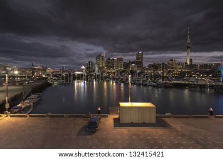 Auckland City Lights/Auckland from the Viaduct with super yachts and fishing vessels in the foreground - stock photo