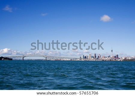 Auckland City, New Zealand viewed from the water on a bright sunny day