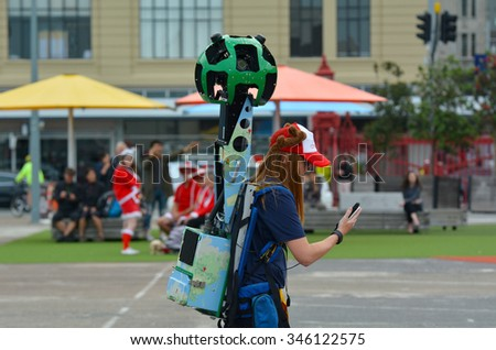 AUCKLAND - DEC 02 2015:Google Street View camera operator at work.It's a technology featured in Google Maps and Google Earth that provides panoramic views from positions along streets in the world. - stock photo