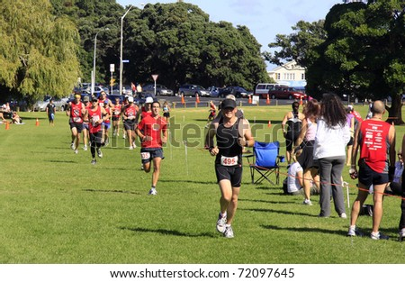AUCKLAND- Feb. 27: Participants in the Cathay Pacific  Auckland marathon run sprint to the finish line on Sunday Feb. 27,2011 at  Orakei, Auckland, New Zealand - stock photo