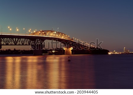 Auckland Harbour Bridge lit up at night - stock photo