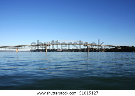 Auckland Harbour Bridge viewed from the ocean on a bright sunny morning - stock photo