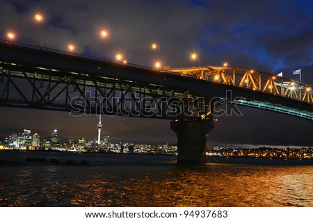 Auckland harbour bridge with Auckland city at night in New Zealand.
