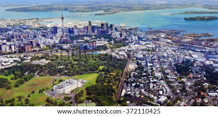 AUCKLAND - JAN 31 2016:Aerial view of Auckland War Memorial Museum against  Auckland financial center and Harbor bridge. Auckland is the financial capital of new Zealand - stock photo