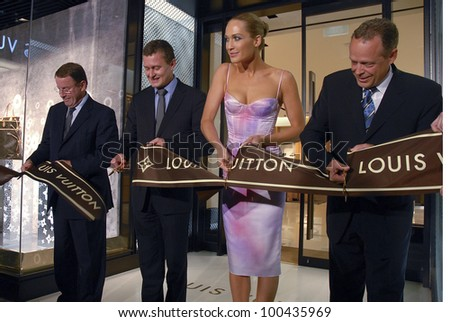 AUCKLAND - JUNE 5: Dignitaries cut the ribbon marking the opening of Louis Vuitton's new flagship store in Queen Street on June 5, 2008 in Auckland, New Zealand. - stock photo