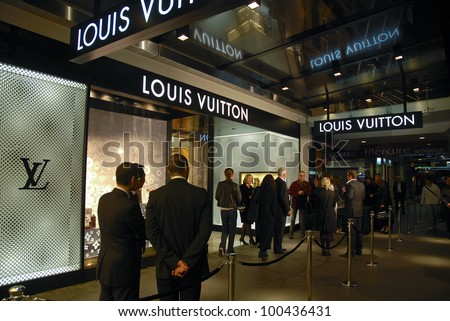 AUCKLAND - JUNE 5: Guests and party-goers arrive for the opening night celebrations Louis Vuitton's new flagship store in Queen Street on June 5, 2008 in Auckland, New Zealand. - stock photo