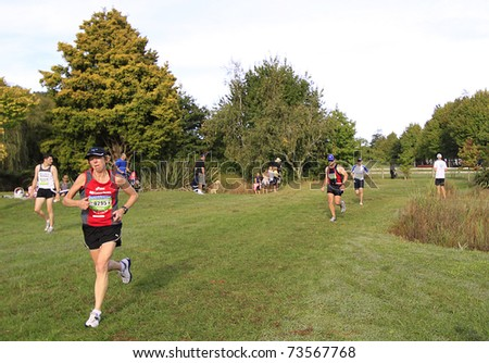 AUCKLAND- Mar. 20: Runners and participants in the Coatesville Half Marathon run sprint to the finish line on March 20, 2011 at Coatesville, Auckland, New Zealand - stock photo