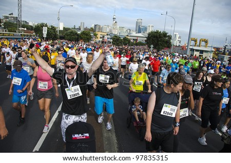 AUCKLAND- MARCH 18: Participants of Auckland Round the Bays, one of the world's largest fun-runs with an estimated 70,000 entrants, on March 18, 2012 in Auckland, New Zealand. - stock photo