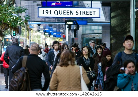 AUCKLAND - MAY 29:Asian people in Queen street on May 29 2013.In 2011, of every 100 Aucklanders, 22 of them are of Asian decent and by 2021, Auckland is expected to have 27% people of Asian decent. - stock photo