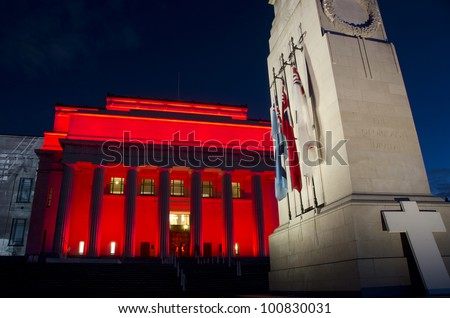 AUCKLAND, NEW ZEALAND - APRIL 24: Auckland's War Memorial Museum is bathed in red light April 24, 2012 on the eve of ANZAC Day remembrance commemorations.  ANZAC Day is in memory of lives lost at war. - stock photo