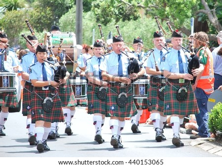 AUCKLAND, NEW ZEALAND: 25 DECEMBER 2010 - Scottish bagpipe band is marching down the street during Christmas Parade in Auckland  - stock photo