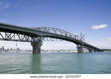 Auckland New Zealand, Harbour Bridge with City in Background - stock photo