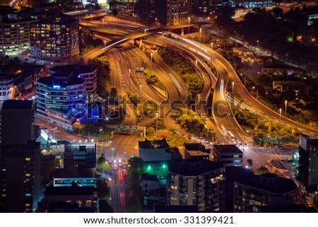 AUCKLAND, NEW ZEALAND .OCTOBER 6,2015; Night traffic in Auckland, view of the Sky Tower - stock photo