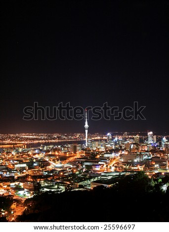 Auckland night skyline vertical - stock photo