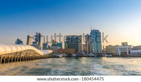 AUCKLAND, NZ - JAN 18 2014: Ferry leaving the Princes Warf with the city skyline on the background on January 18 2014.  - stock photo