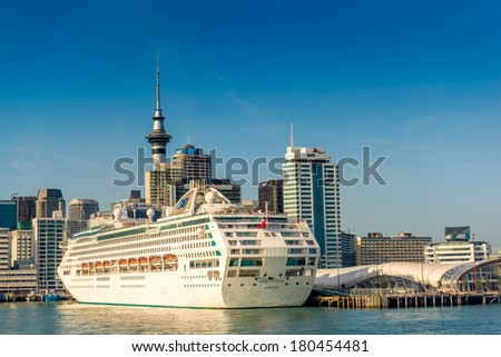 AUCKLAND, NZ - JAN 19 2014: Ferry leaving the Princes Warf with the Skytower and the Dawn Princess Cruiseship in the background on January 19 2014.  - stock photo