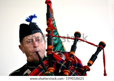 AUCKLAND,NZ - JUNE 01 2014:Bagpipe player celebrate the Queen's Birthday on the first Monday of June each year as the Queen of the United Kingdom being the head of state. - stock photo