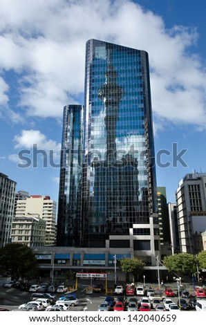 AUCKLAND, NZ - MAY 29:Reflection of Auckland Sky Tower on May 29 2013.The tower is designed to withstand wind in excess of 200Ã?Â??km/h (120Ã?Â??mph) and resist earthquakes with a 1,000 year return period.