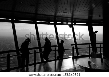 AUCKLAND, NZ - OCT 08: Visitors at the Sky Tower observation deck on Oct 08 2013.At 328 metres, the Sky Tower is the tallest man-made structure in New Zealand.(BW)