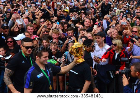AUCKLAND,  NZL - NOV 04 2015:Richie McCaw showing thousands of people the Web Ellis trophy in Victoria Park Auckland, New Zealand.The All Blacks are the holders of the Rugby World Cup in 2011 and 2015