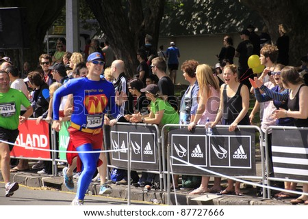 AUCKLAND- OCT. 30: Unidentified participant in Auckland marathon dresses as superhero run sprint to the finish line on Sunday Oct. 30,2011 in  Auckland, New Zealand - stock photo