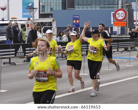 AUCKLAND - OCTOBER 31: Participants in the Adidas Auckland marathon run sprint to the finish line on Sunday Oct. 31,2010 at  Auckland, New Zealand - stock photo