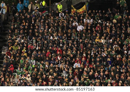 AUCKLAND-SEPT. 22: Fans and spectators of the Rugby World Cup 2011 match between South Africa and Namibia at the North Shore Stadium in Auckland, New Zealand on September 22, 2011. - stock photo