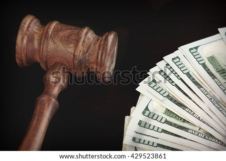 Auctioneers or Judges Hammer or Gavel with Money Heap or Pile On Black Wooden Background Auction Or Trial Concept - stock photo
