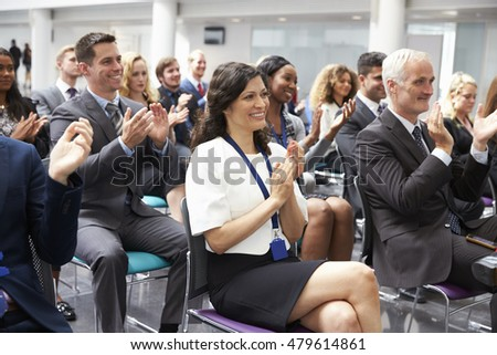 Audience Applauding Speaker After Conference Presentation
