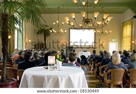 audience at a conference in a classical surrounding - stock photo