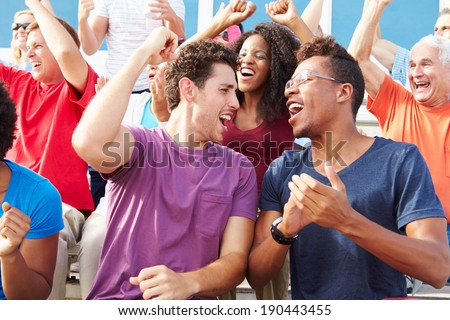 Audience Cheering At Outdoor Concert Performance - stock photo