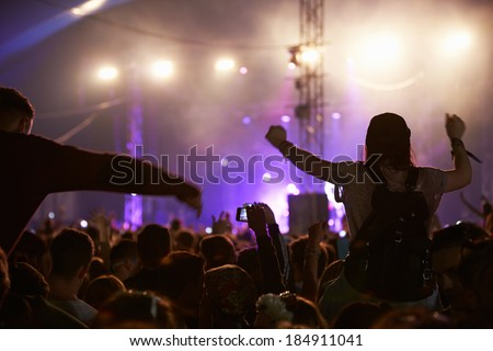 Audience Enjoying Themselves Music Concert - stock photo